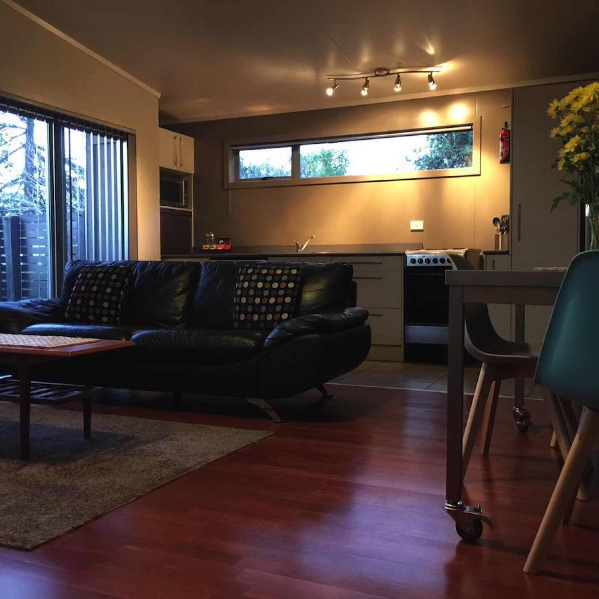 The cottage has a spacious and sunny living and dining area.